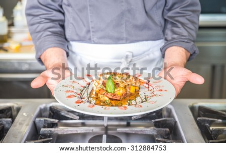 close up on a fish starter dish in a kitchen restaurant. concept about food - stock photo