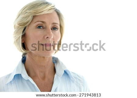 Close up on a mature woman looking away over white background with copy space - stock photo