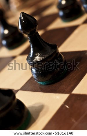 Close up on a pawn on a chess board. - stock photo