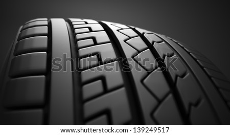 Close up on a tire on a dark background. - stock photo