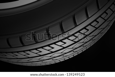 Close up on a tire on a dark background. View from the bottom. - stock photo