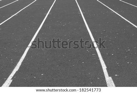 Close up on athletics track - stock photo