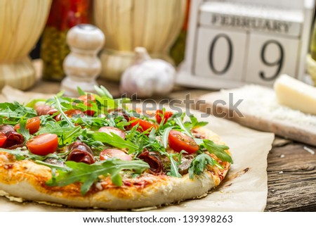 Close-up on baked pizza with ham - stock photo