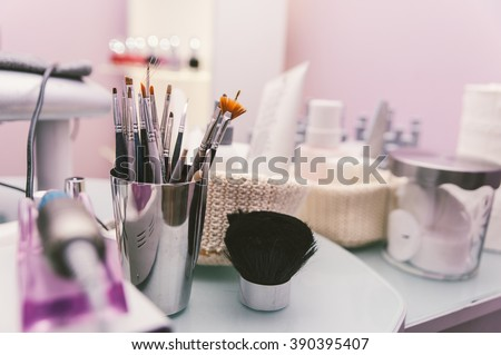 Close up on beauty tools and gadgets ion a beauty saloon - stock photo