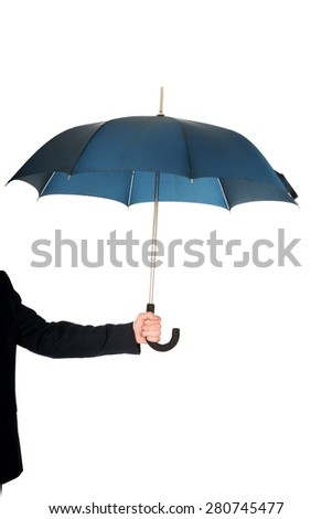 Close up on businessman hand with an umbrella. - stock photo