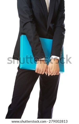 Close up on businesswoman holding a binder. - stock photo