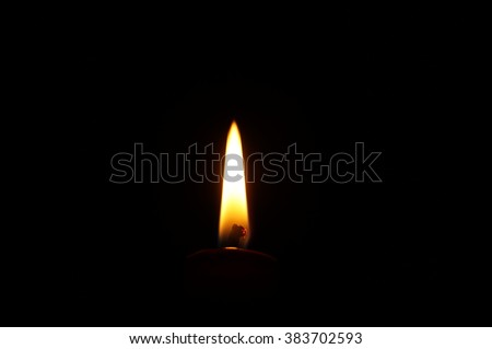 Close-up on candle flame on black background. Flame alone. - stock photo