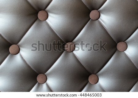 Close up on dark brown leather sofa texture background - stock photo