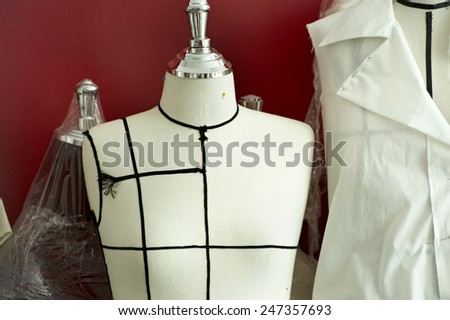 Close up on fabric dummy on background - stock photo