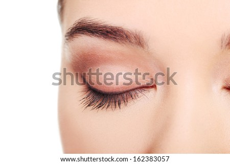 Close up on female's face- eye. Isolated on white.  - stock photo