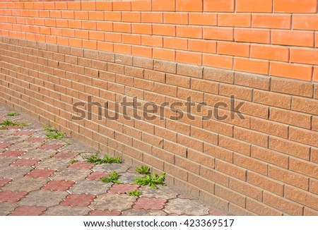 Close up on foundation waterproofing. New construction waterproofing basement walls from outside with detail of a pavement to walk. - stock photo