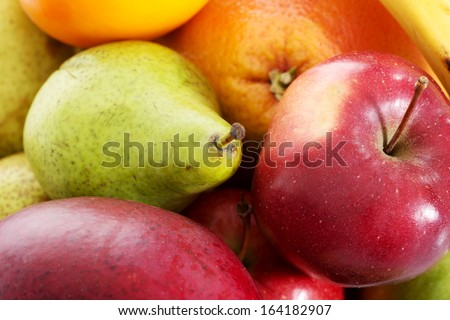 Close up on fruit composition- apples, peaches and banana. - stock photo