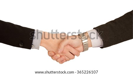 Close-up on man and woman in bisiness suits shake hands. Handshake isolated - stock photo