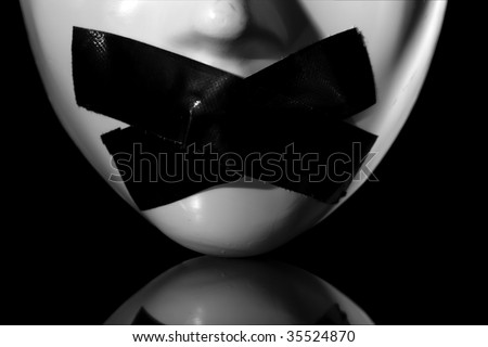 close up on masks mouth with masking tape on it ,on reflective surface , clipping path available - stock photo
