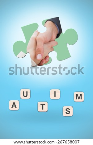 Close up on new partners shaking hands against blue background with vignette - stock photo