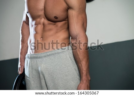 Close Up On Perfect Abs. Strong Bodybuilder Training His Six Pack. Man Doing Abs Exercise - stock photo