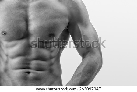 Close up on perfect abs. Strong bodybuilder with six pack, fit body - stock photo