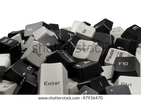 Close-up on Pile of Black and White Computer Keyboard Keys isolated on white background - stock photo