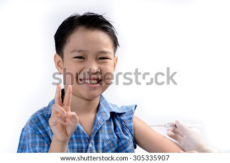 Close up on Smiling boy Young asian boy injection by doctor hand in glove. Heath and hospital concept - stock photo