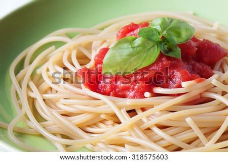 Close up on spaghetti pasta with tomato sauce  - stock photo