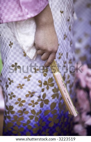 Close up on the fan held by a tradtional Japanese dancer. - stock photo