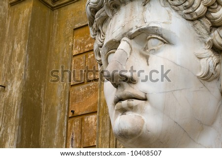 Close-up on the head of a very large statue of Roman emperor Augustus - stock photo