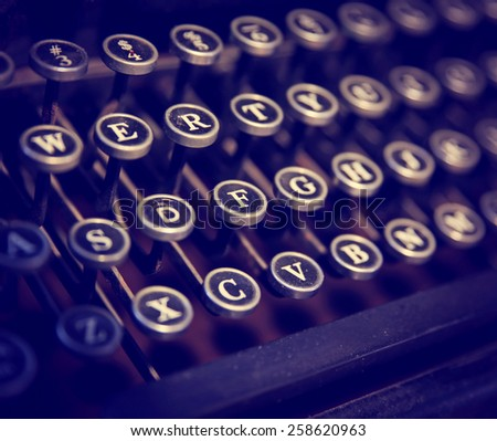 close up on the keys of an antique typewriter toned with a retro vintage instagram filter app or action effect  - stock photo