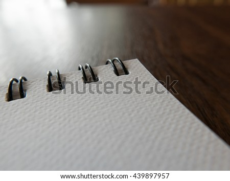 Close-up Open blank notebook on the wooden table, Selective focus - stock photo