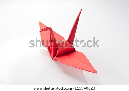 close up Origami red paper bird on white background. - stock photo