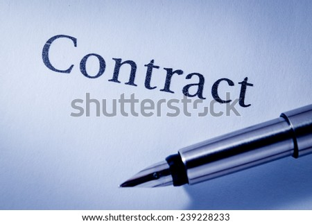 Close up overhead view of the nib of a fountain pen lying on a sheet of blank white paper headed - Contract - stock photo