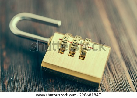 Close up pad lock on wooden background - vintage effect style pictures - stock photo
