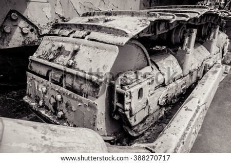 Close up part of a construction excavator loade machine Track steel steel chains Tank wheels Excavator drive belt / Black and white - stock photo