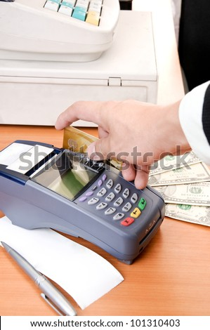Close up Payment machine on during using Credit card from customer in shopping mall - stock photo