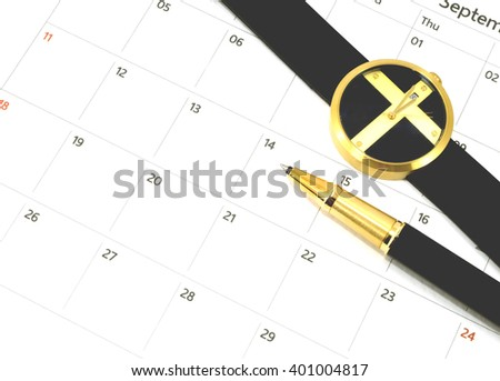 close up pen and watch on calender date in business concept - stock photo