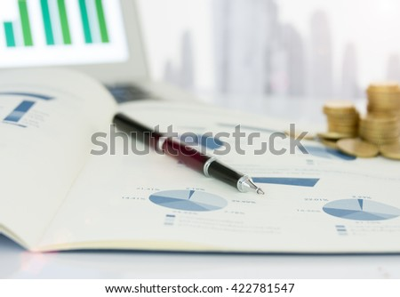 Close-up pen on financial report. Concept of data analysis, investment planning, business analytics. - stock photo
