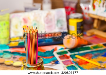 Close up pencils art supplies paints for painting and drawing - stock photo