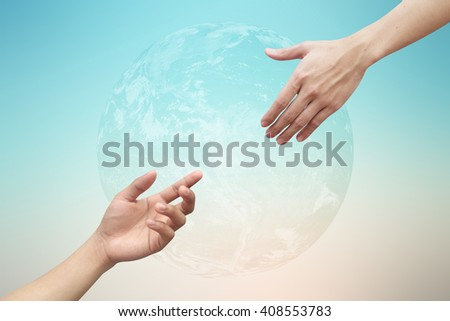 close up people hand reaching together for developing a new world concept:risk of global warming:solution for healing and safe global life idea:helping hand:Elements of this image furnished by NASA - stock photo