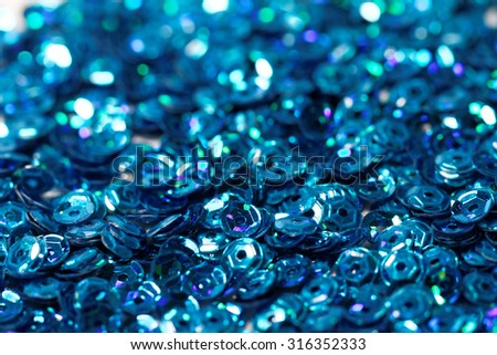 Close up photo lots of blue sequin - stock photo