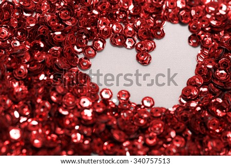 Close up photo lots of red sequin - stock photo