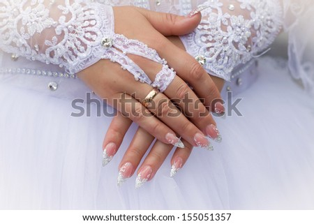 Close-up photo of a caucasian  hands on their wedding day - stock photo