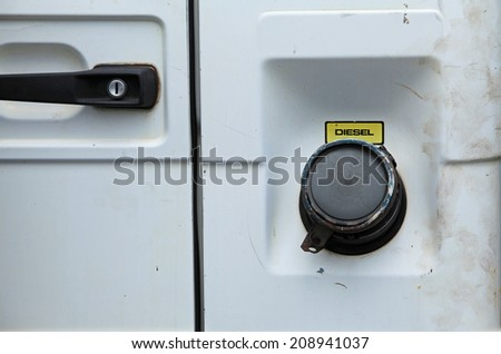 Close up photo of a diesel tank cover of a car with diesel engine - stock photo