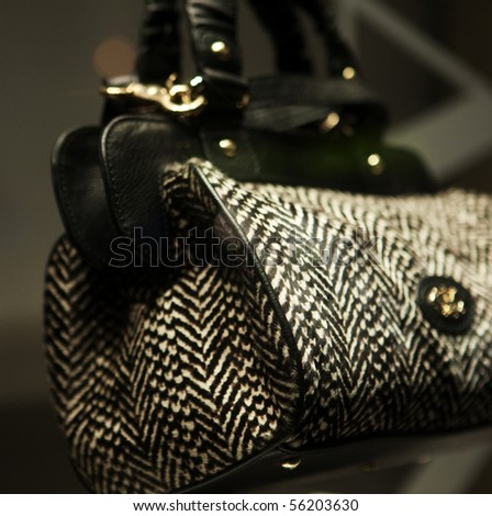 Close-up photo of a handbag exposed in a shop-window - stock photo