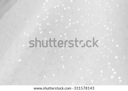 Close up photo of a sequined wedding dress - stock photo