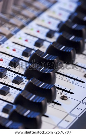 Close-up photo of a sound mixing board - stock photo