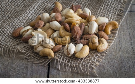 Close up photo of  almond, cashew and pistachios pile.  - stock photo