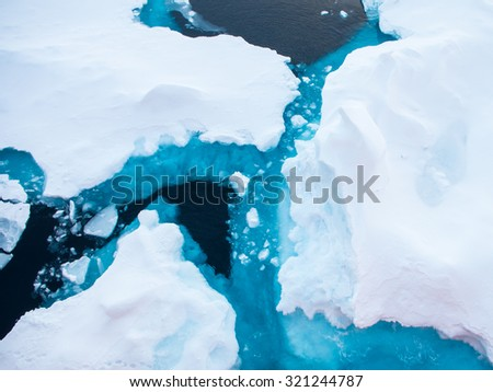 Close up photo of beautiful blue ice in Arctic ocean - nature background - stock photo