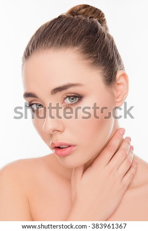 Close up photo of cute young relaxed girl touching her neck - stock photo