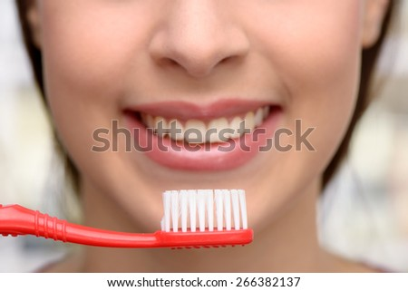 Close up photo of female patient with toothbrush at dentist office. Concept for teeth hygiene - stock photo