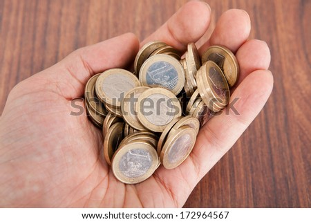 Close-up Photo Of Hand Holding Euro Coins - stock photo