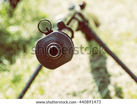 Close up photo of heavy sniper rifle from World War II. Gun scene. Gun barrel. Armed conflict. Military theme. Portable weapon. Retro photo filter. Shooting position. - stock photo